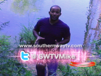 Darrell Lee standing by river explaining about SouthernWayTv.com video blog